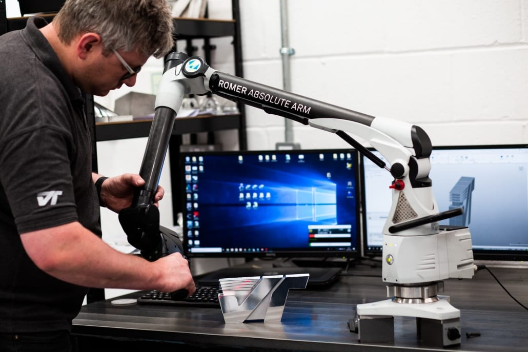 Photo of Ashley Budd operating the CMM 7-axis arm to carry out a full inspection